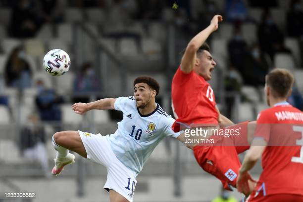 Scotland forward Che Adams tackles Luxembourger defender Dirk Carlson during the friendly football match between Luxembourg and Scotland at the Josy...