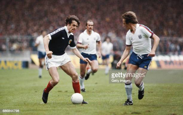 Scotland forward Joe Jordan takes on England full back Phil Neal as Mick Mills looks on during the Home International match between England and...
