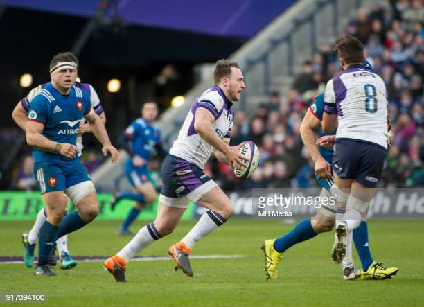 Scotland full back Stuart Hogg finds a gap in the French defence at Murrayfield on February 11 2018 in Edinburgh Scotland