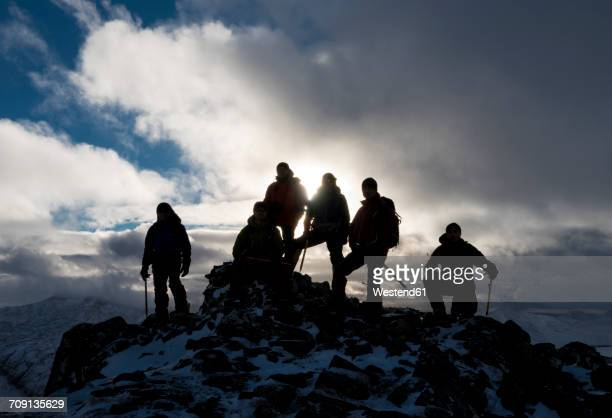 UK, Scotland, Glencoe, mountaineers on top of Buachaill Etive Beag