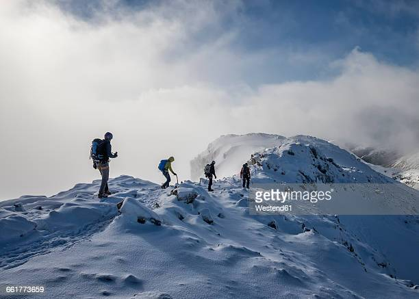 scotland, glencoe, stob dearg, mountaineering in winter - mountaineering stock pictures, royalty-free photos & images