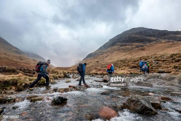 uk, scotland, glencoe, trekking at sron na lairig - scotland stock pictures, royalty-free photos & images