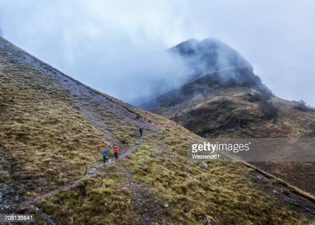 uk, scotland, glencoe, trekking at stob coire nan lochan - glencoe scotland stock pictures, royalty-free photos & images