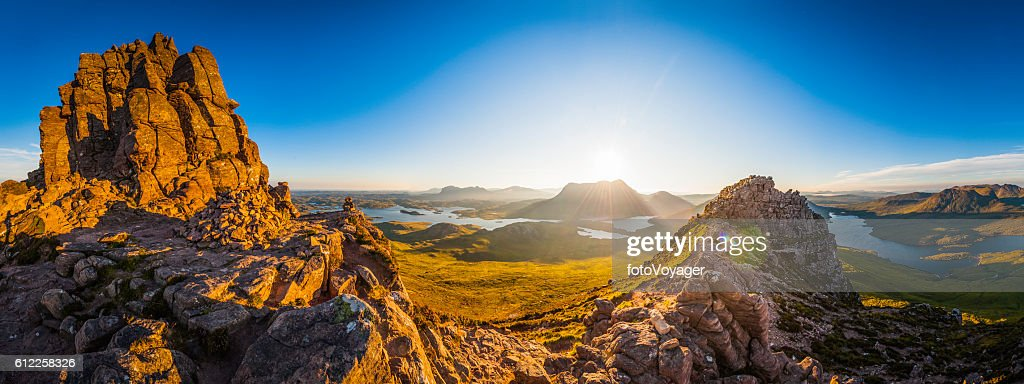Scotland glorious dawn over Highland mountain peaks lochs glens panorama : Foto de stock