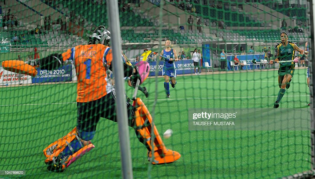 Scotland goalkeeper Abigail Walker blocks a shot while challenged by Marsha Mareschia of South Africa during their field hockey match at the Major Dhyan Chand National Stadium during the XIX Commonwealth Games in New Delhi on October 5, 2010. South Africa leads 2-0 as play continues. AFP PHOTO/Tauseef MUSTAFA