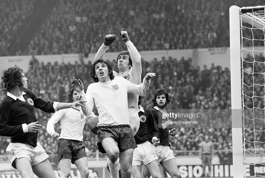 Scotland goalkeeper Bobby Clark comes off his line to punch the ball under pressure from Martin Peters of England during the British Championship football match at Wembley Stadium in London on 19th May 1973. England won 1-0.