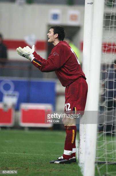 Scotland goalkeeper Craig Gordon gees up the defenders the World Cup Qualifier Group Five match between Italy and Scotland at the San Siro on March...