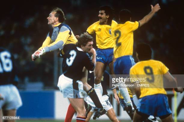 Scotland goalkeeper Jim Leighton punches clear of team mates Roy Aitken and Murdo MacLeod as well as Brazil's Ricardo Rocha Jorginho and Careca