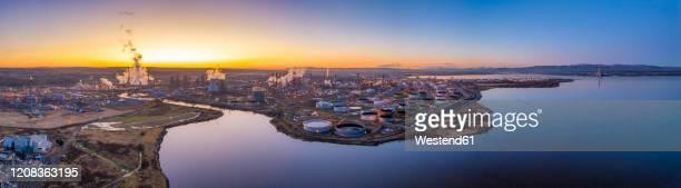uk, scotland, grangemouth, aerial panorama ofgrangemouthrefinery at sunset - panoramic stock pictures, royalty-free photos & images