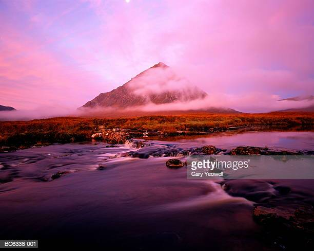 scotland, highland, glencoe, buchaille etive mor, stream in fore - yeowell stock photos and pictures