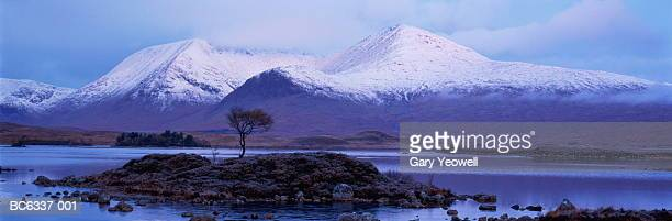 scotland, highland, rannoch moor, black mount and loch in winter - yeowell stock pictures, royalty-free photos & images