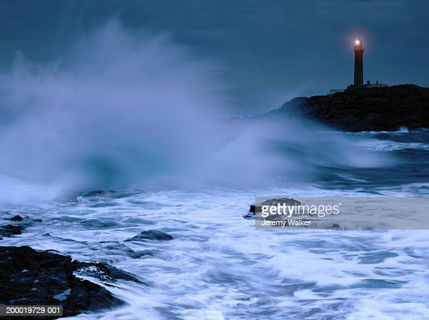scotland, highlands, ardnamurchan point, illuminated lighthouse - lighthouse stock pictures, royalty-free photos & images