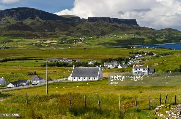 Houses in Staffin Bay, facing the Trotternish peninsula, Isle of Skye, Inner Hebrides archipelago.