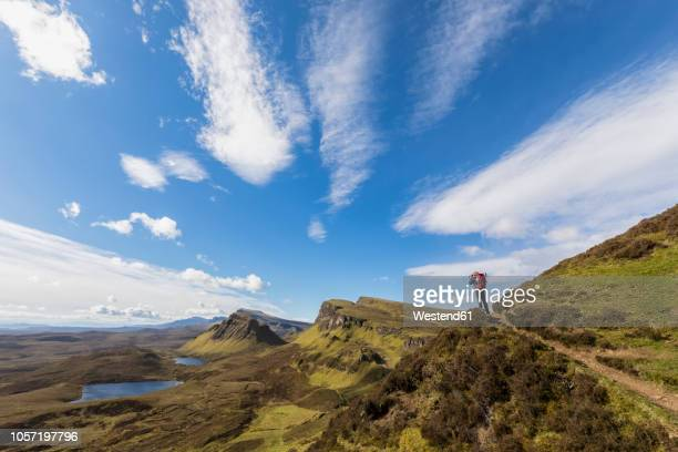 uk, scotland, inner hebrides, isle of skye, trotternish, quiraing, tourist on hiking trail - scotland stock pictures, royalty-free photos & images