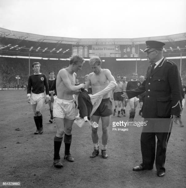 Scotland inside-left Denis Law and England outside-left Bobby Charlton, both of Manchester United, exchange shirts for souvenirs after the final...