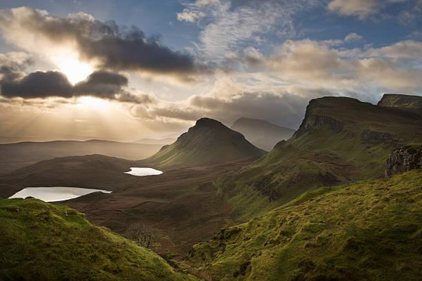 UK, Scotland, Isle of Skye, Quirang, beams of sunrise