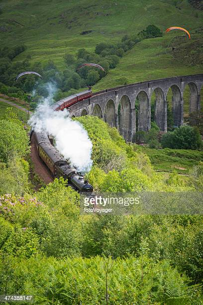 scotland jacobite steam train and paragliders over glenfinnan viaduct highlands - mallaig stock photos and pictures