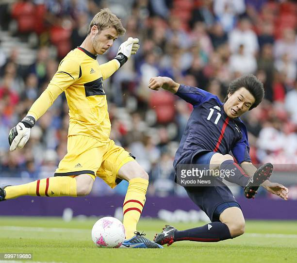 GLASGOW Scotland Japan's Kensuke Nagai competes for the ball during the first half of an Olympic men's soccer Group D opener against Spain at Hampden...