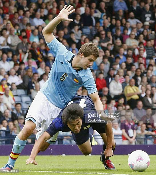 GLASGOW Scotland Japan's Kensuke Nagai falls as he vies for the ball during the first half of an Olympic men's soccer Group D opener against Spain at...