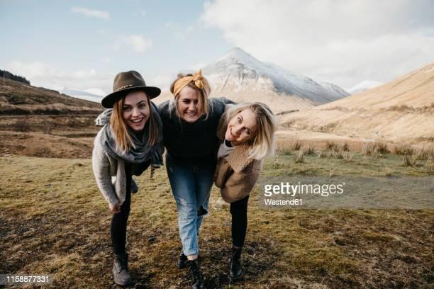 uk, scotland, loch lomond and the trossachs national park, happy female friends in rural landscape - in the park day 3 imagens e fotografias de stock