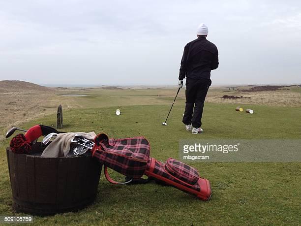 Scotland, Man playing golf