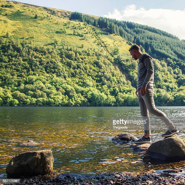 UK, Scotland, Man stepping on stones