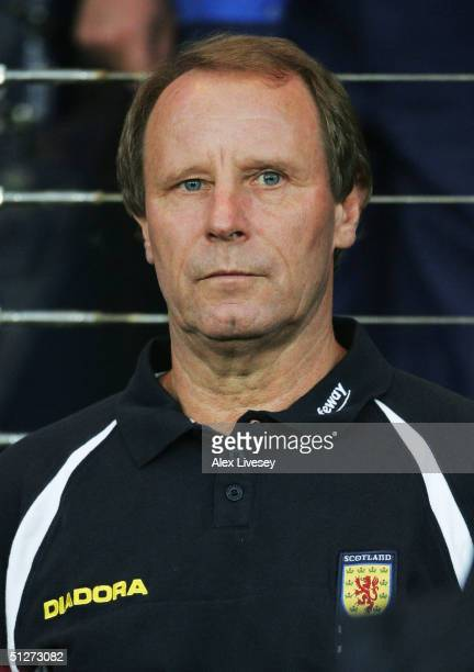 Scotland manager Berti Vogts watches during the 2006 FIFA World Cup Group five Qualifying game between Scotland and Slovenia at Hampden Park on...