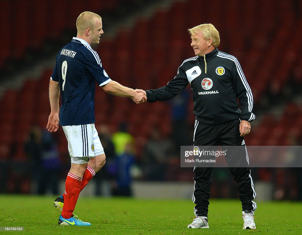 Scotland manager Gordon Strachan greets Steven Naismith as he leaves the pitch at the end of the FIFA 2014 World Cup Qualifying Group A match between Scotland and Croatia at Hampden Park on October 15, 2013.