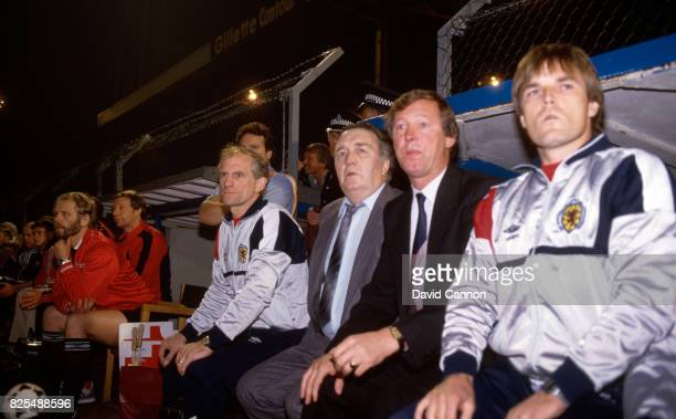 Scotland manager Jock Stein and Alex Ferguson look on from the bench during the 1986 FIFA World Cup Qualifier between Wales and Scotland at Ninian...