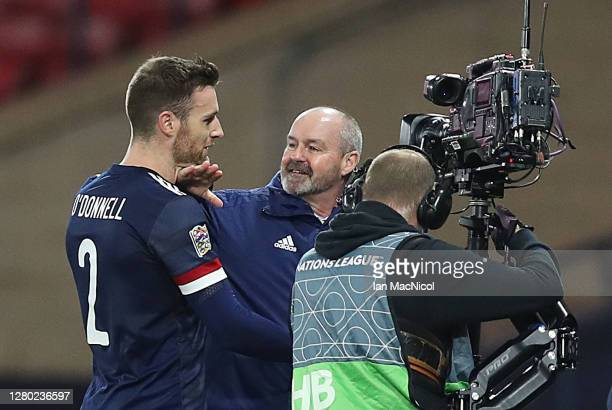 Scotland manager Steve Clarke embraces Stephen O'Donnell at full time during the UEFA Nations League group stage match between Scotland and Czech...