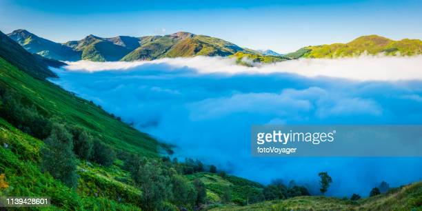 scotland mist in glen nevis below green highland mountains panorama - grampian scotland stock pictures, royalty-free photos & images