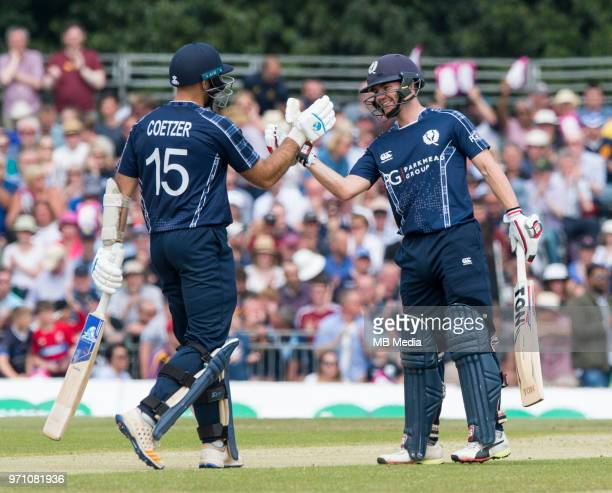 Scotland openers Kyle Coetzer and Matthew Cross celebrate reaching 100 in the first innings of the One Day International at the Grange Cricket Club...