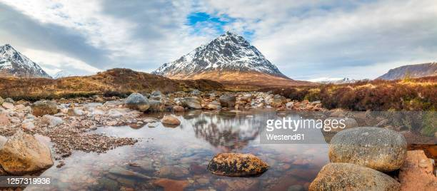 uk, scotland, panorama of river coupall withbuachaille etive mor mountain in background - glen etive mor stock pictures, royalty-free photos & images