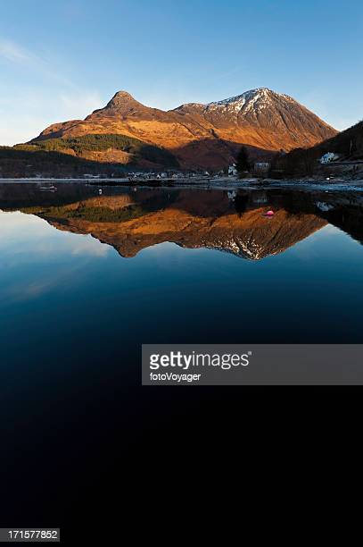 Scotland Pap of Glencoe mountain reflecting in Loch Leven Highlands