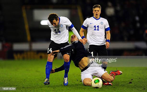 Scotland player Alan Hutton is challenged by Konstantin Vassiljev of Estonia during the International Friendly match between Scotland and Estonia at...