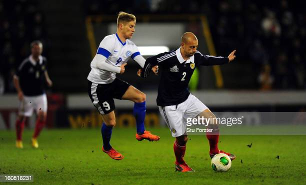 Scotland player Alan Hutton is challenged by Tarmo Kink of Estonia during the International Friendly match between Scotland and Estonia at Pittodrie...
