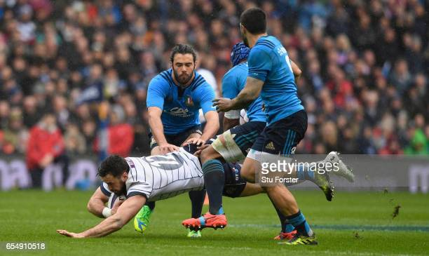Scotland player Alex Dunbar is upended during the RBS Six Nations match between Scotland and Italy at Murrayfield Stadium on March 18 2017 in...