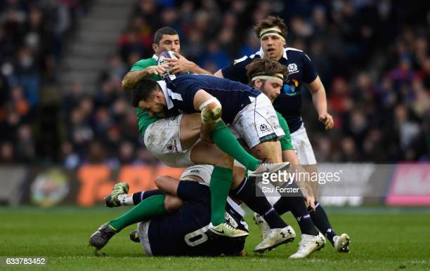 Scotland player Alex Dunbar puts in a tackle on Rob Kearney during the RBS Six Nations match between Scotland and Ireland at Murrayfield Stadium on...