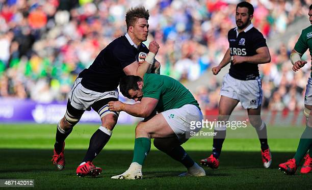 Scotland player David Denton runs through a tackle during the RBS Six Nations match between Scotland and Ireland at Murrayfield Stadium on March 21...