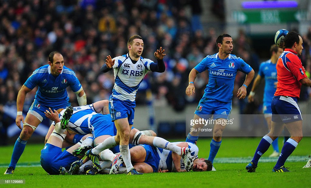 Scotland player Greig Laidlaw has his pass intercepted by the head of referee Jaco Peyper (r) during the RBS Six Nations match between Scotland and Italy at Murrayfield Stadium in Scotland, United Kingdom