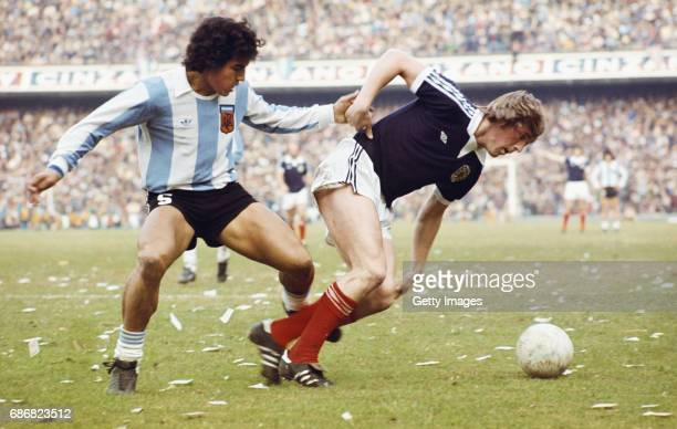 Scotland player Kenny Dalglish competes for a loose ball with an Argentina defender during a friendly International between Argentina and Scotland at...