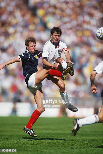 Scotland player Neil Simpson challenges Bryan Robson of England during a goalless draw between the two sides at Hampden Park on may 23 1987 in...