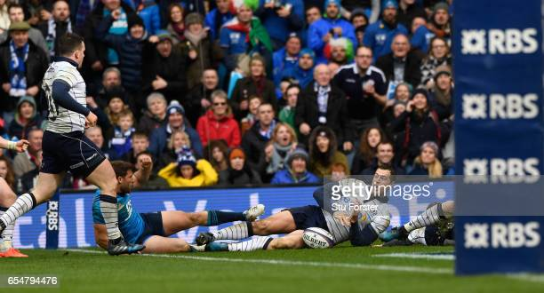 Scotland player Tim Visser scores the third try during the RBS Six Nations match between Scotland and Italy at Murrayfield Stadium on March 18, 2017...