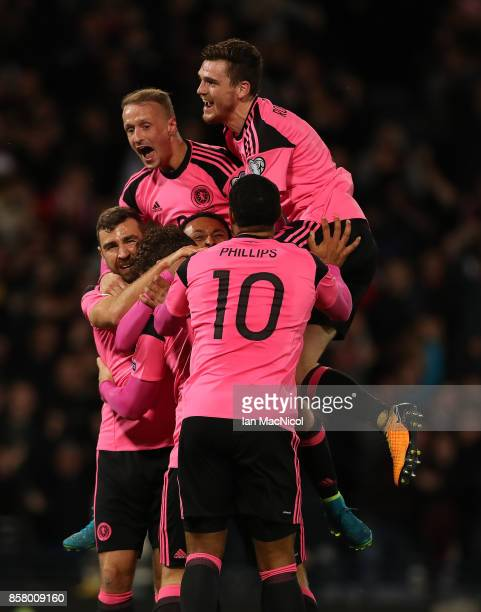 Scotland players celebrates after Martin Skrtel of Slovakia scores in his own net during the FIFA 2018 World Cup Qualifier between Scotland and...