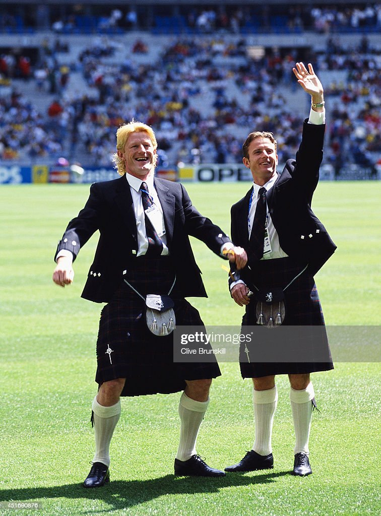 Scotland players Colin Hendry (l) and Kevin Gallacher wave to fans whilst wearing their kilts before the opening FIFA 1998 World Cup match between Brazil and Scotland at Stade Francais on June 10, 1998 in Toulon, France.