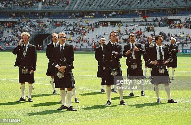Scotland players including Scott Gemmil Jim Leighton Tommy Boyd Craig Burley and Barry Ferguson look on dressed in their Kilts before the opening...
