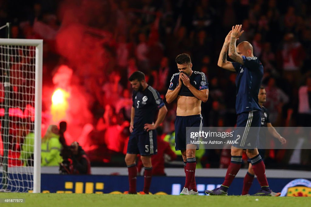 Scotland players look dejected after conceding a goal in the last minute during the UEFA EURO 2016 qualifier between Scotland and Poland at Hampden Park on October 8, 2015 in Glasgow, Scotland.