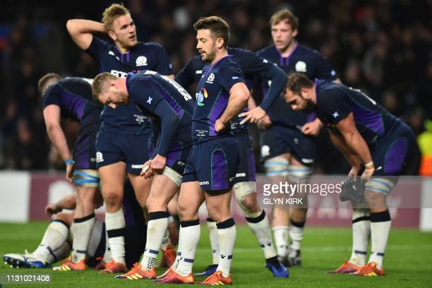 Scotland players react after conceding a late try during the Six Nations international rugby union match between England and Scotland at the...