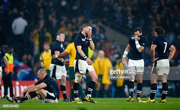 Scotland players react after the 2015 Rugby World Cup Quarter Final match between Australia and Scotland at Twickenham Stadium on October 18 2015 in...