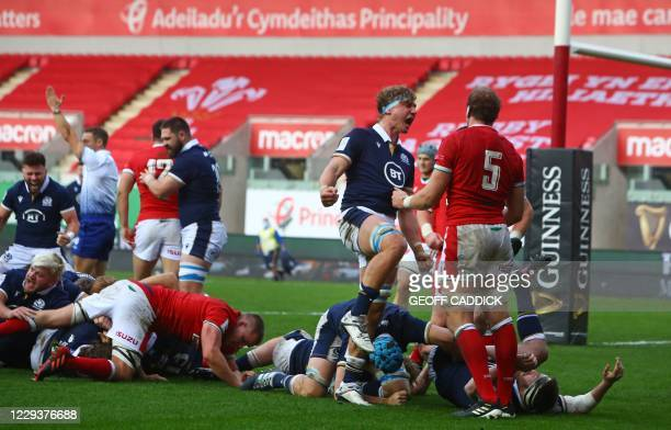Scotland players react as they go over for a try during the 2020 Six Nations Championship rugby union match between Wales and Scotland at the Parc y...